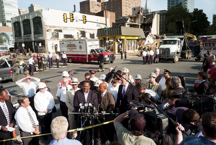 Philadelphia Mayor Michael Nutter (center right) and License and Inspections commissioner Carlton Williams update the media on the status of the search operations. The mayor indicated six people were dead and at least 13 others were injured.