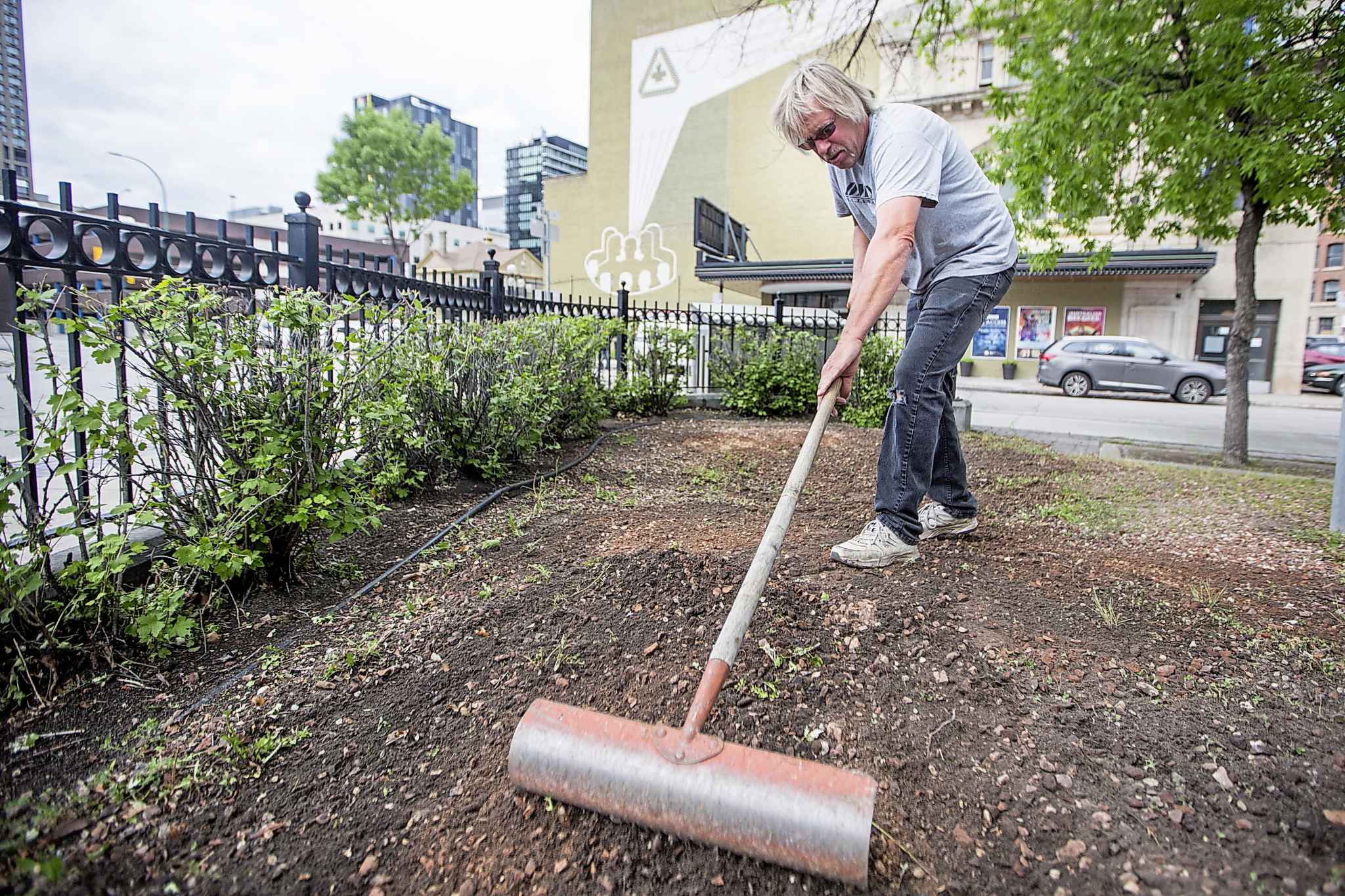 Edward Bell, owner/contractor of Bell's Property Services, cleans up the future patio space.