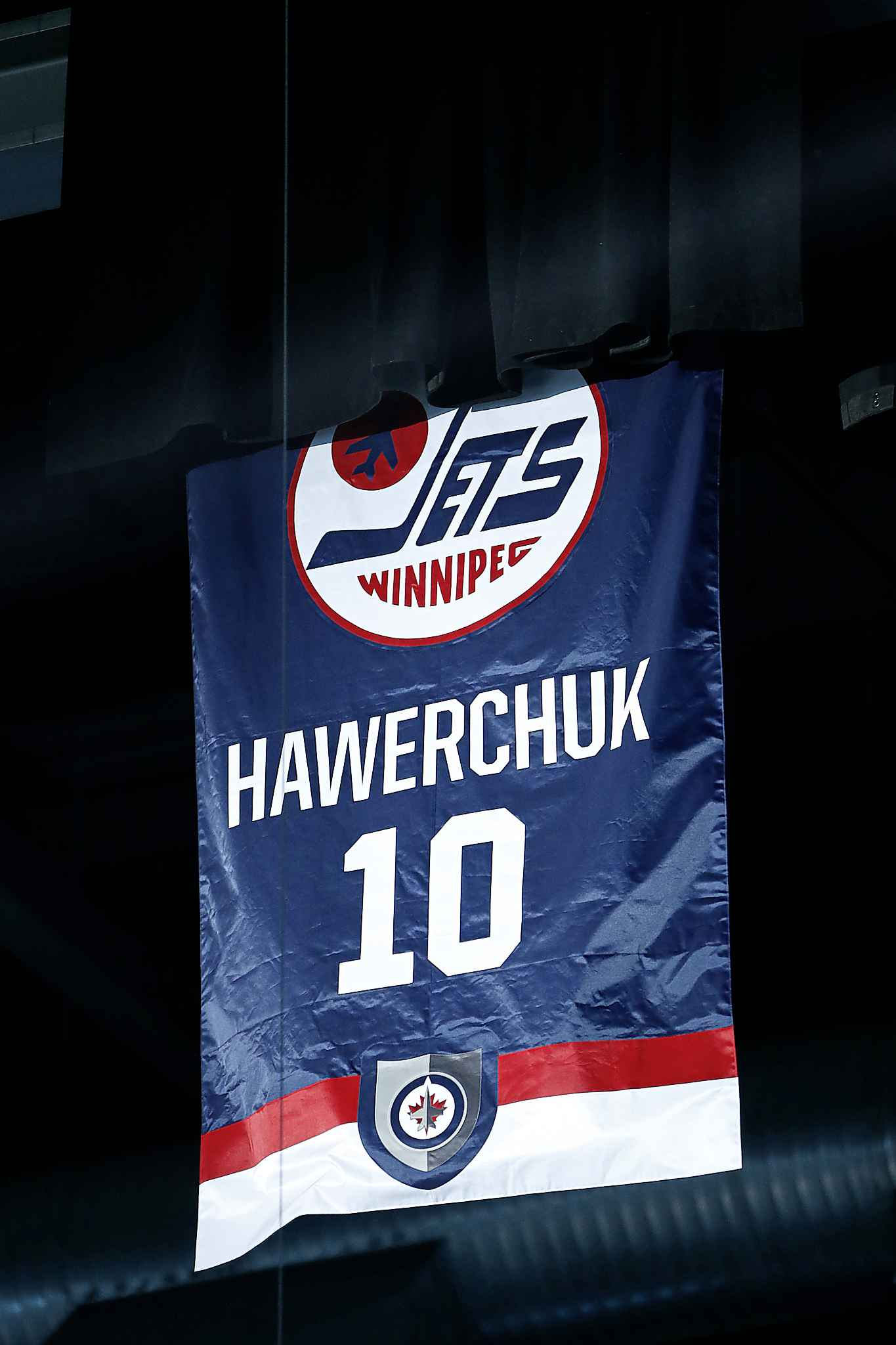 Dale Hawerchuk's number is unveiled in the rafters of BellMTS Place prior to the Jets game against the Arizona Coyotes Tuesday.