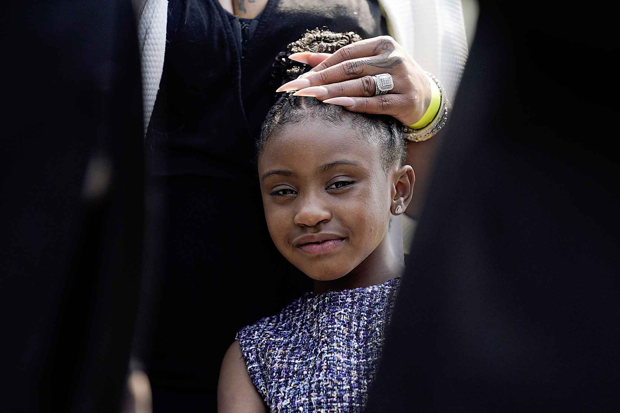 Gianna Floyd, the daughter of George Floyd, listens as family members speak to reporters after meeting with President Joe Biden at the White House, Tuesday, May 25, 2021, in Washington. (AP Photo/Evan Vucci)