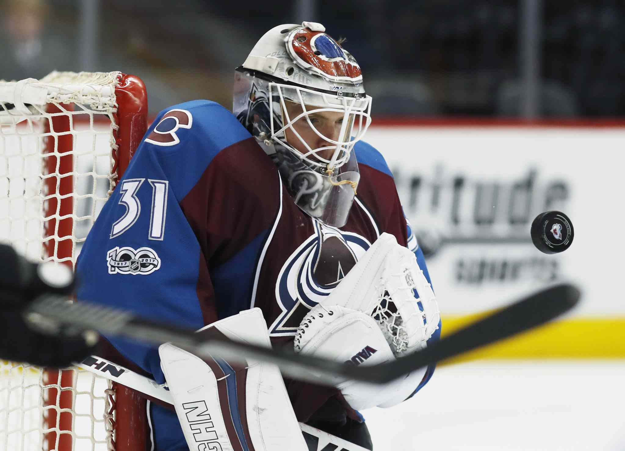 Colorado Avalanche goalie Calvin Pickard watches the puck bounce off his chest after stopping a shot against the Chicago Blackhawks in the second period of an NHL hockey game Tuesday, April 4, 2017, in Denver. (AP Photo/David Zalubowski)