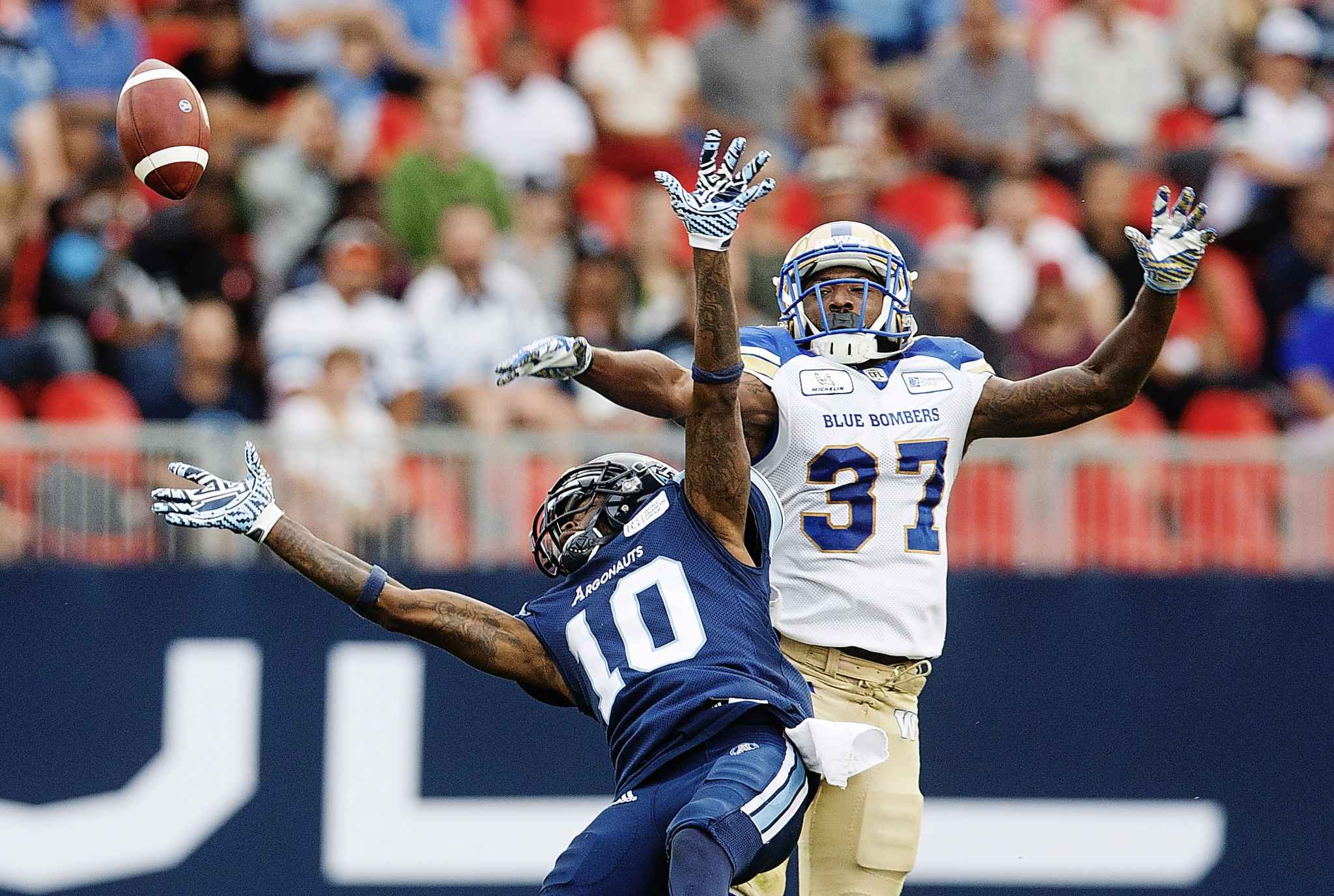 The Winnipeg Blue Bombers are trying to re-sign Brandon Alexander, right, to stabilize their secondary.