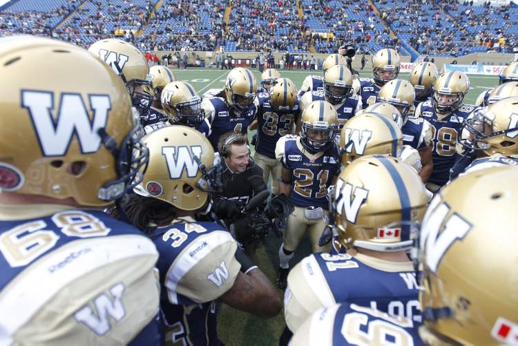 The Winnipeg Blue Bombers take a moment before facing the Montreal Alouettes at the Canad Inns Stadium Saturday.