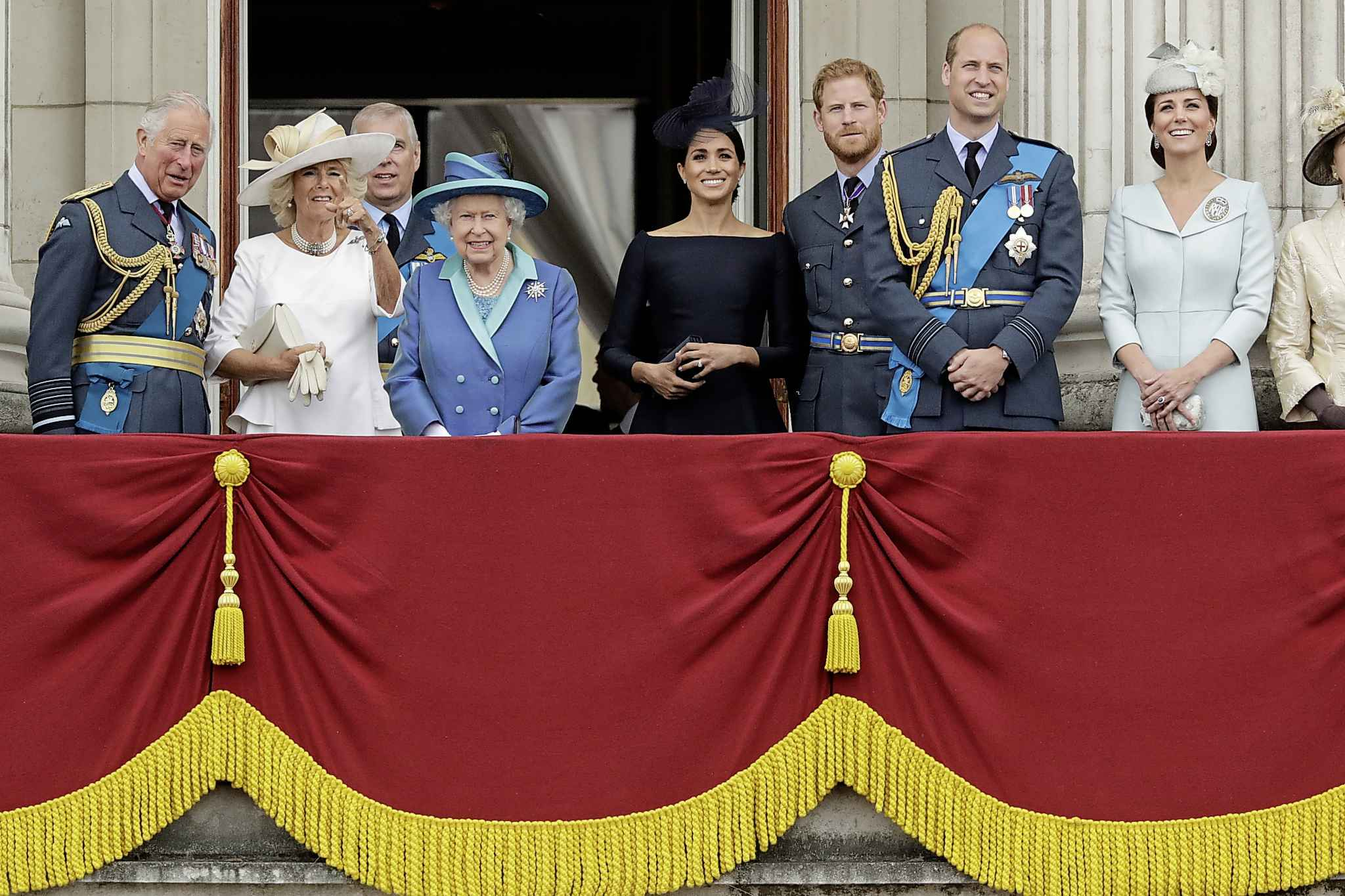 FILE - In this Tuesday, July 10, 2018 file photo, members of the royal family gather on the balcony of Buckingham Palace, with (from left) Prince Charles, Camilla the Duchess of Cornwall, Prince Andrew, Queen Elizabeth II, Meghan the Duchess of Sussex, Prince Harry, Prince William and Kate the Duchess of Cambridge.  Queen Elizabeth II says she has agreed to grant Prince Harry and Meghan their wish for a more independent life that will see them move part-time to Canada. (AP Photo/Matt Dunham, File)