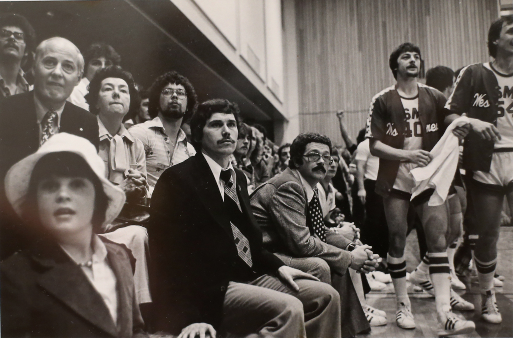 U of W basketball coach Bruce Enns (centre in dark jacket) in the 1970s. (Supplied)