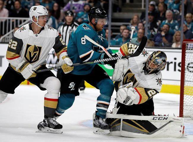 San Jose Sharks' Joe Pavelski (8) reacts after scoring a goal against Vegas Golden Knights goalie Marc-Andre Fleury, right, during the first period of Game 1 of an NHL hockey first-round playoff series Wednesday, April 10, 2019, in San Jose, Calif. At left is Golden Knights defenseman Nick Holden. (AP Photo/Ben Margot)