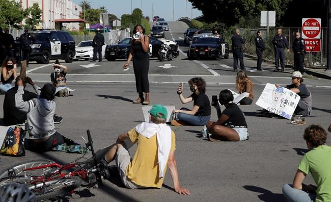 Protestors block an intersection outside the Oakland police department on Thursday, May 28, 2020, in Oakland, Calif. (AP Photo/Ben Margot)