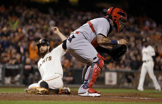 Giants beat Cards 8-2, extend wild-card gap over St. Louis