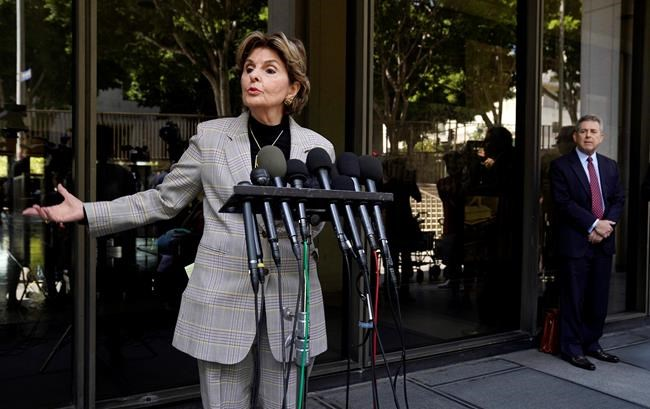 Attorney Gloria Allred, who represents several of Harvey Weinstein's accusers, speaks to reporters after an arraignment for the convicted rapist and former movie mogul on additional sexual assault charges in California, Wednesday, July 21, 2021, at the Clara Shortridge Foltz Criminal Justice Center in Los Angeles. Looking on at right is Weinstein's attorney Mark Werksman. (AP Photo/Chris Pizzello)