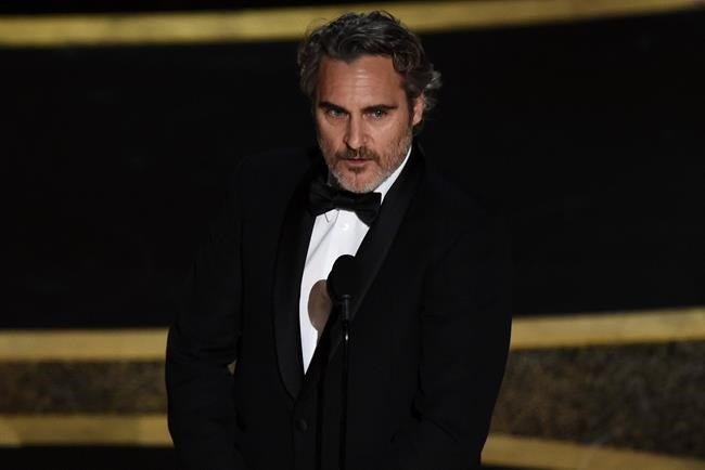 "Joaquin Phoenix accepts the award for best performance by an actor in a leading role for ""Joker"" at the Oscars on Sunday, Feb. 9, 2020, at the Dolby Theatre in Los Angeles. (AP Photo/Chris Pizzello)"