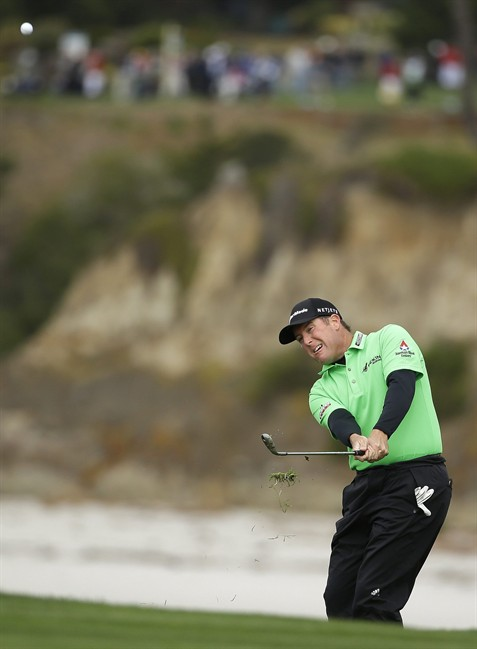 D.A. Points chips the ball up to the sixth green of the Pebble Beach Golf Links during the second round of the AT&T Pebble Beach Pro-Am golf tournament on Friday, Feb. 7, 2014, in Pebble Beach, Calif. (AP Photo/Eric Risberg)