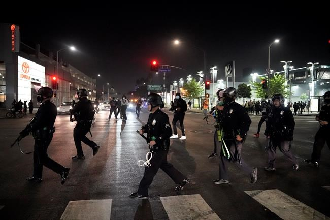 Police move into position during a protest on Election Day, Tuesday, Nov. 3, 2020, in Los Angeles. (AP Photo/Jae C. Hong)