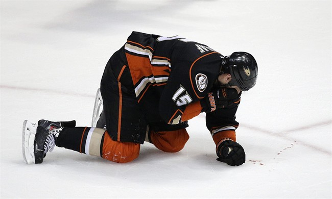 Anaheim Ducks' Ryan Getzlaf bleeds after he was hit in the face by a puck during the third period in Game 1 of the first-round NHL hockey Stanley Cup playoff series against the Dallas Stars on Wednesday, April 16, 2014, in Anaheim, Calif. The Ducks won 4-3. (AP Photo/Jae C. Hong)