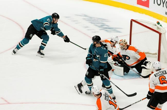 San Jose Sharks right wing Timo Meier (28) scores a goal for his first hat trick, against Philadelphia Flyers goaltender Carter Hart (79) during the third period of an NHL hockey game in San Jose, Calif., Saturday, Dec. 28, 2019. The Sharks won 6-1. (AP Photo/John Hefti)