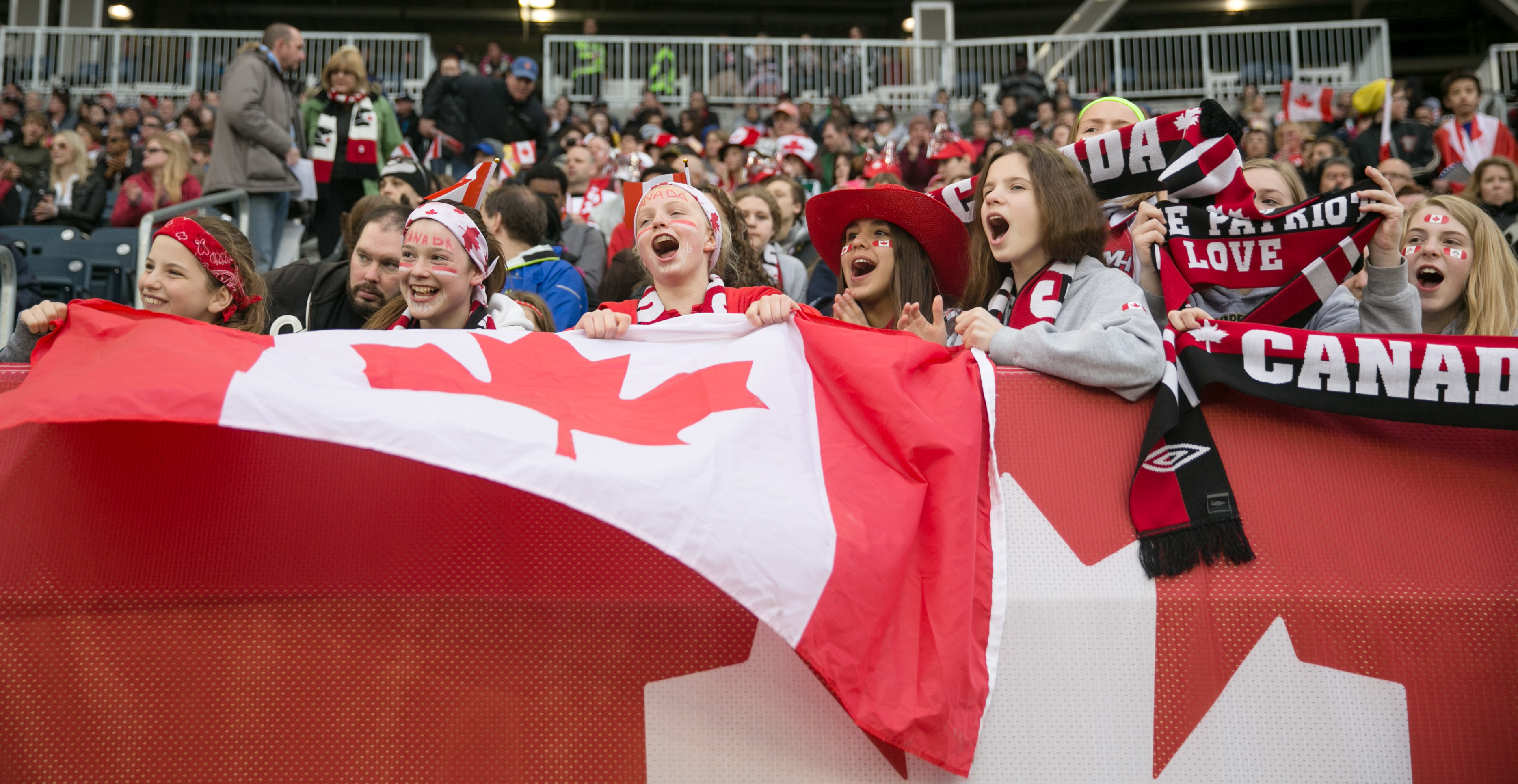 Young Team Canada fans cheer during Canada women's soccer against Team USA at Investors Group Field.