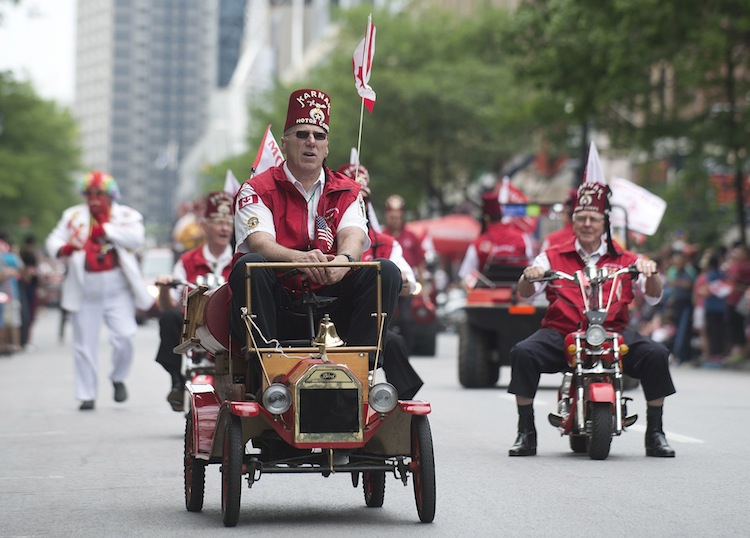 Members of the Shriners entertain the crowd as they participate in the annual Canada Day parade in Montreal. (Graham Hughes / The Canadian Press)