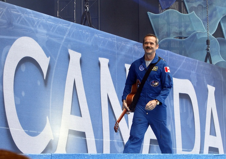 Canadian astronaut Chris Hatfield leaves the stage after singing at the Canada Day celebrations on Parliament Hill, in Ottawa. (Fred Chartrand / The Canadian Press)