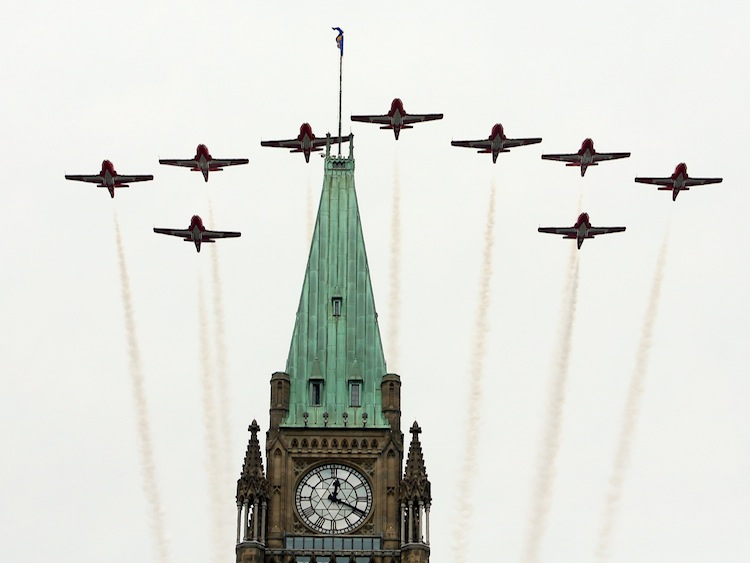 The Snowbirds fly over the Peace Tower at the Canada Day celebrations on Parliament Hill, in Ottawa. (Fred Chartrand / The Canadian Press)