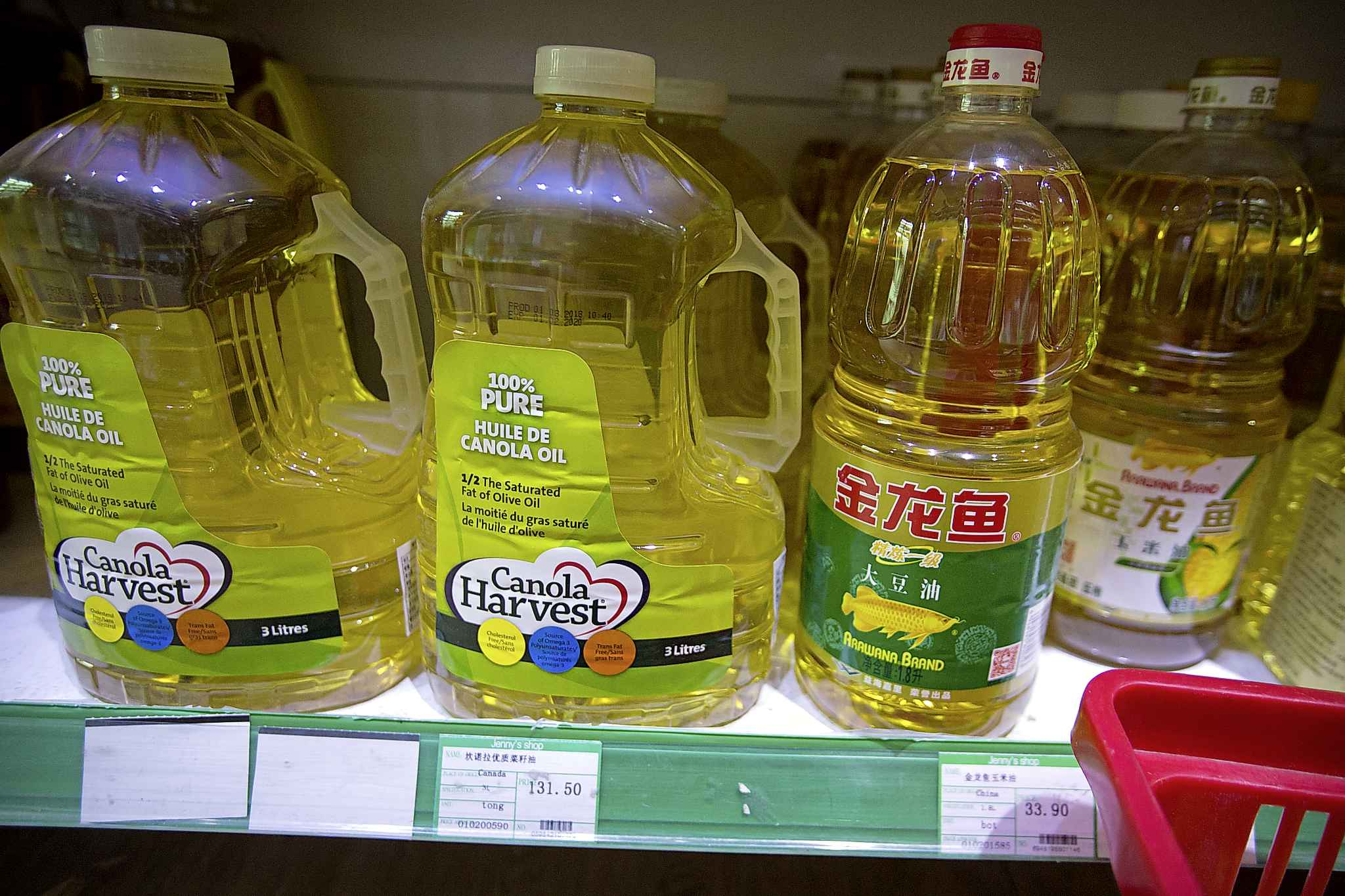 Bottles of Canola Harvest brand canola oil, manufactured by Canadian agribusiness firm Richardson International, on the shelf of a grocery store in Beijing, China.