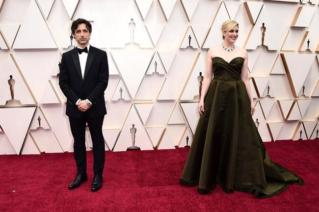 Noah Baumbach, left, and Greta Gerwig arrive at the Oscars on Sunday, Feb. 9, 2020, at the Dolby Theatre in Los Angeles. (Photo by Jordan Strauss/Invision/AP)