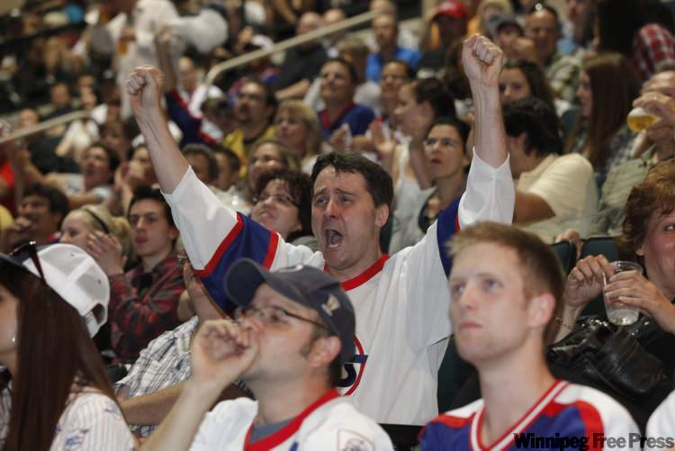 Thousands of fans celebrate at the MTS Centre in Winnipeg Friday after the city's new NHL team is named the Jets. JOHN WOODS / WINNIPEG FREE PRESS