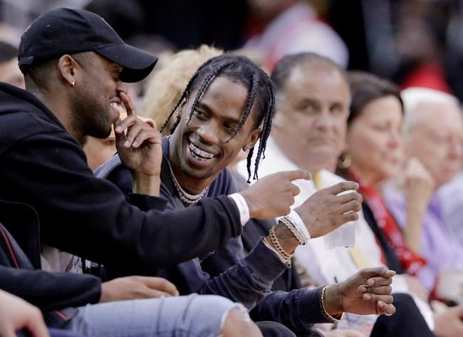 Rapper Travis Scott designs special shirts for Rockets fans