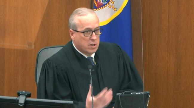 In this image from video, Hennepin County Judge PeterCahill reads instructions to the jury before closing arguments, Monday, April 19, 2021, in the trial of former Minneapolis police officer Derek Chauvin at the Hennepin County Courthouse in Minneapolis. Chauvin is charged in the May 25, 2020 death of George Floyd. (Court TV via AP, Pool)