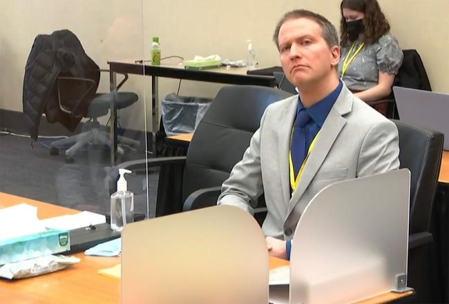 In this image from video, former Minneapolis police Officer Derek Chauvin listens as his defense attorney Eric Nelson gives closing arguments as Hennepin County Judge Peter Cahill preside Monday, April 19, 2021, in the trial of Chauvin at the Hennepin County Courthouse in Minneapolis. Chauvin is charged in the May 25, 2020 death of George Floyd , Minn. (Court TV via AP, Pool)