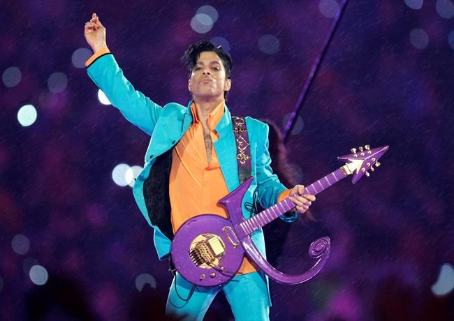 Prince performs during the halftime show at the Super Bowl XLI football game in Miami. Nearly a year after Prince died from an accidental drug overdose in his suburban Minneapolis studio and estate investigators
