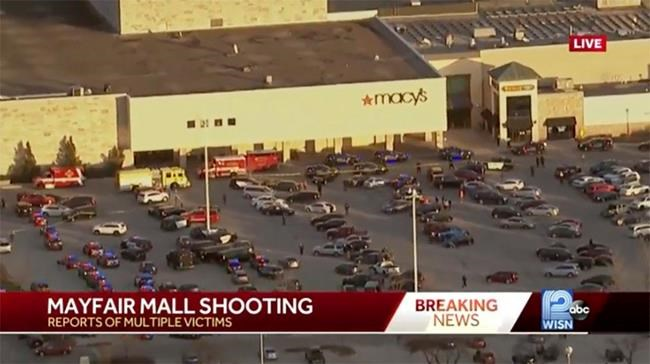 """In this image from video provided by WISN-TV, emergency crews gather at the Mayfair Mall in Wauwatosa, Wis., on Friday, Nov. 20, 2020. A police dispatcher says officers are responding to """"a very active situation"""" at the suburban Milwaukee mall. The dispatcher said she could not immediately provide further details. Witnesses told WISN-TV that they heard what they believed were eight to 12 shots. (WISN-TV via AP)"""
