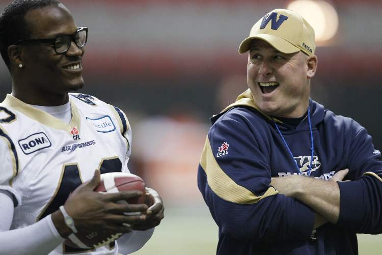 Paul LaPolice and Odell Willis joke around during practice in Vancouver the day before the 2011 Grey Cup. (John Woods / WINNIPEG FREE PRESS)