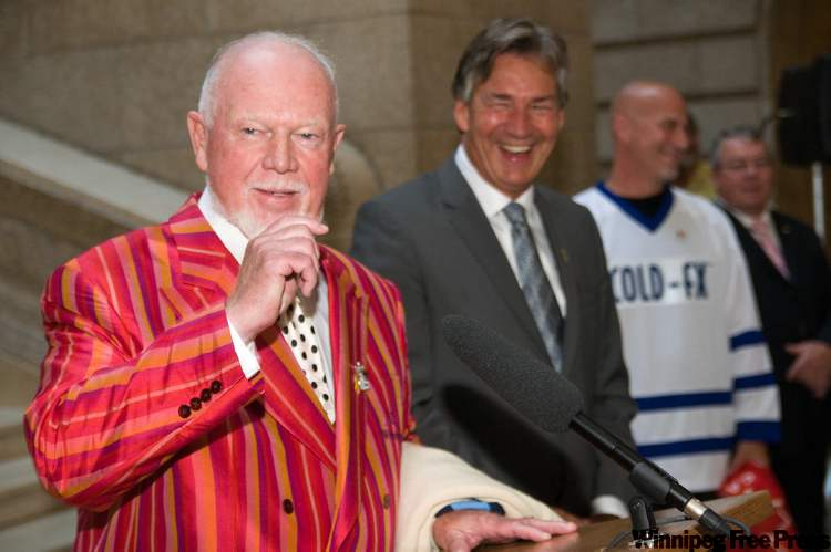 "Don Cherry speaks at the Manitoba legislature Sept. 24, 2009, as part of the Premier Gary Doer's proclaimation ""honouring Canada's Olympic and Paralympic Athletes Day"" in Manitoba. He is joined at the event by  Doer (from left), Paralympian Paul Rosen, and founding president of the International Paralympic Committee, Bob Steadward."