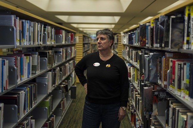 Maureen O'Reilly, a librarian and president of the Toronto Public Library Workers Union, poses for a portrait in Toronto on Thursday, March 24, 2016. They're part-time employees without health benefits or pensions who work split shifts at a number of different locations each week. From one paycheque to the next, their income fluctuates, as do their hours. THE CANADIAN PRESS/Christopher Katsarov