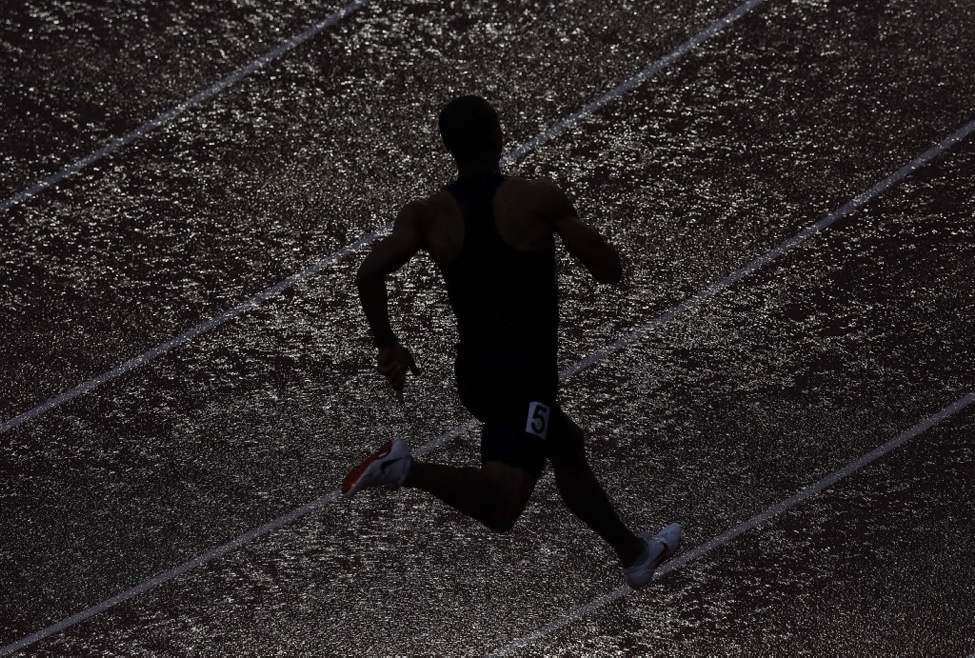 Ashton Eaton runs in the 400m during the decathlon competition at the U.S. Olympic Track and Field Trials, in Eugene, Ore. (AP Photo/Charlie Riedel)