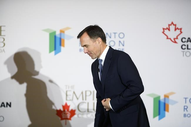 Canadian finance minister Bill Morneau leaves the stage following an armchair discussion hosted by the Toronto Region Board of Trade, The Empire Club and Canadian Club of Toronto, in Toronto, Wednesday, March 20, 2019. THE CANADIAN PRESS/Cole Burston