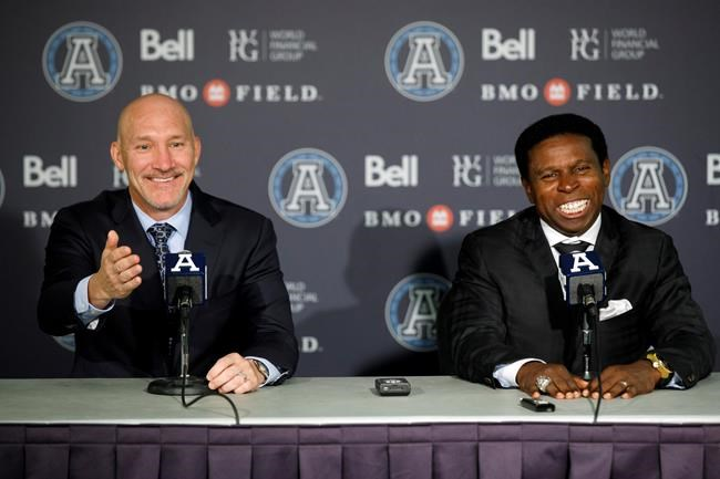 Bill Manning, left, president of the Toronto Argonauts and Mike (Pinball) Clemons speak as Clemons is announced as the new general manager of the Toronto Argonauts during a press conference at BMO Field in Toronto, Tuesday, Oct. 8, 2019. THE CANADIAN PRESS/ Cole Burston