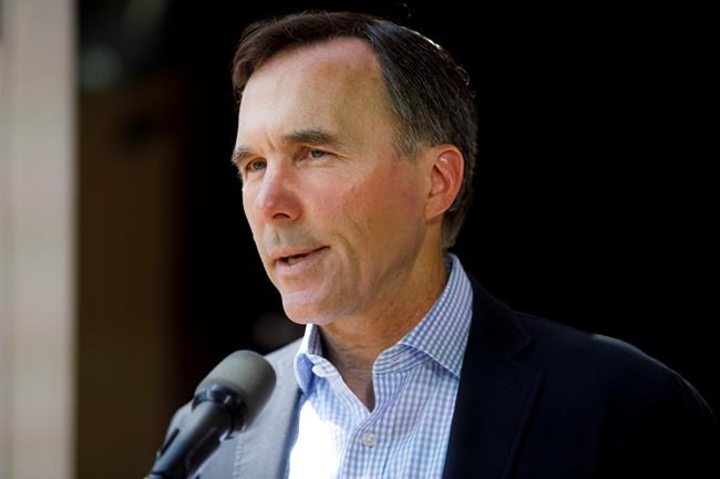Finance Minister Bill Morneau speaks to media during a press conference in Toronto, Friday, July 17, 2020. THE CANADIAN PRESS/Cole Burston