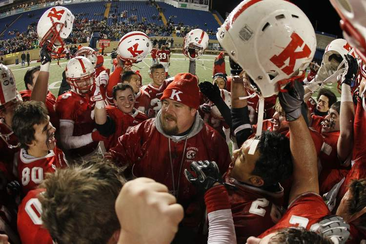 The Kelvin Clippers celebrate their win over the Grant Park Pirates Friday.