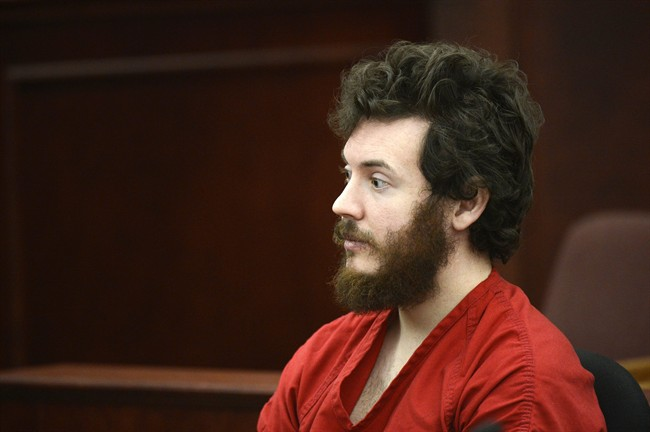 FILE - This March 12, 2013 file photo shows James Holmes, Aurora theater shooting suspect, in the courtroom during his arraignment in Centennial, Colo. Lawyers for Holmes are objecting to a Fox News reporter's request to delay her court appearance to testify about her confidential sources, Tuesday, March 27, 2013. (AP Photo/Denver Post, RJ Sangosti, Pool)
