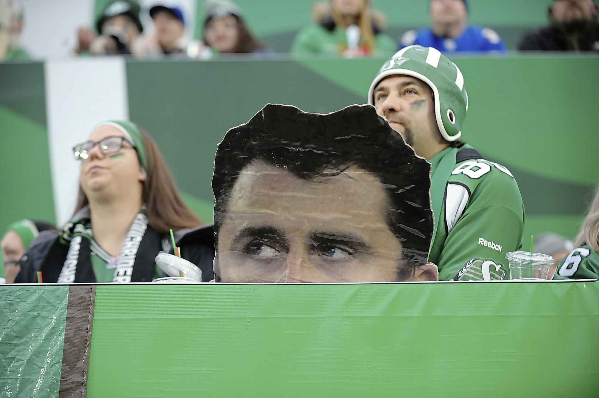Saskatchewan Roughriders behind an image of Winnipeg Blue Bombers quarterback Zach Collaros during the West Division final at Mosaic Stadium in Regina on Sunday. The Roughriders began the season with Collaros as their starting quarterback, then traded him to the Toronto Argonauts after he went down with an injury.