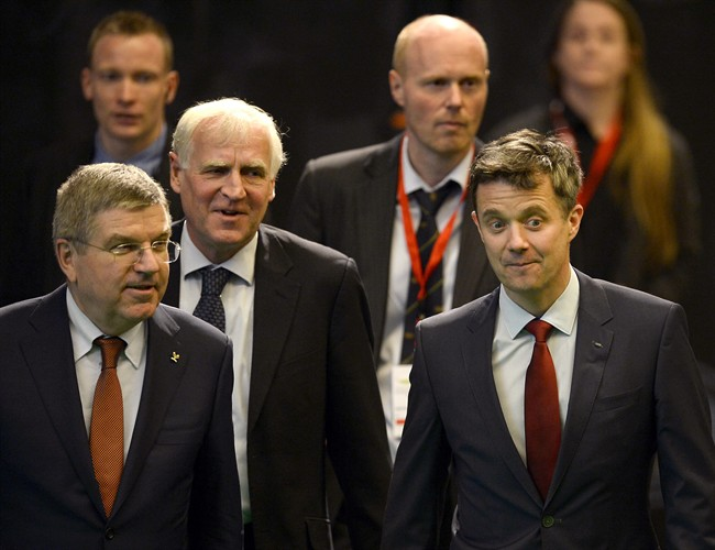 IOC President Thomas Bach of Germany, left, Denmark Sports Federation's (DIF) President Niels Nygaard, second left, Denmark Sports Federation's development manager Morten Molholm, second right, and IOC member, Crown Prince Frederik, attend Denmark's Sports Federation's Congress in Brondby, Denmark Thursday March 5, 2015. (AP Photo/Lars Poulsen/Polfoto) DENMARK OUT