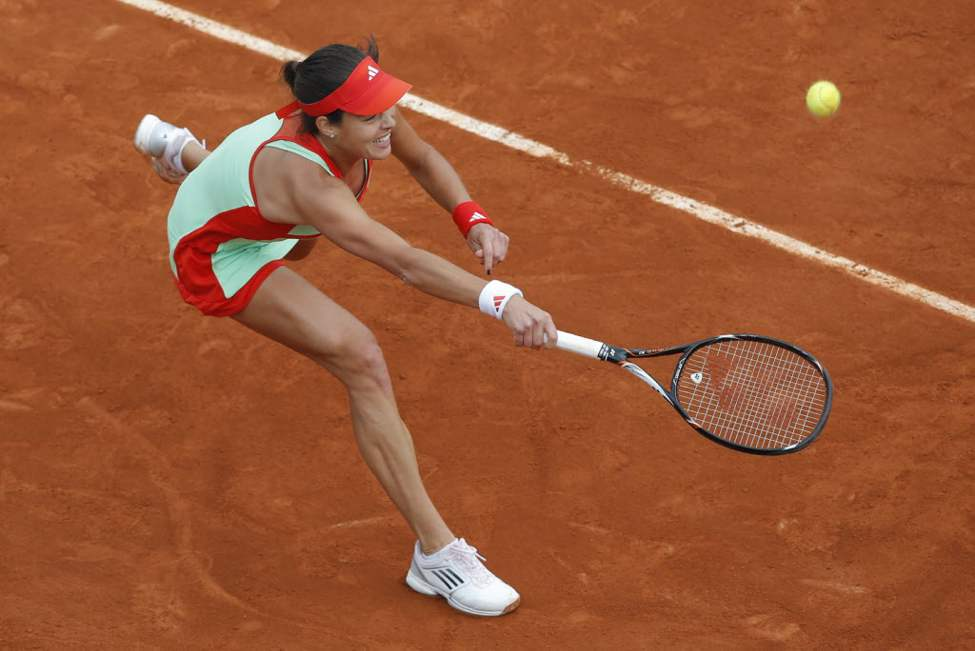 Ana Ivanovic of Serbia returns in her third round match against Sara Errani of Italy at the French Open tennis tournament in Roland Garros stadium in Paris. (AP Photo/Christophe Ena)