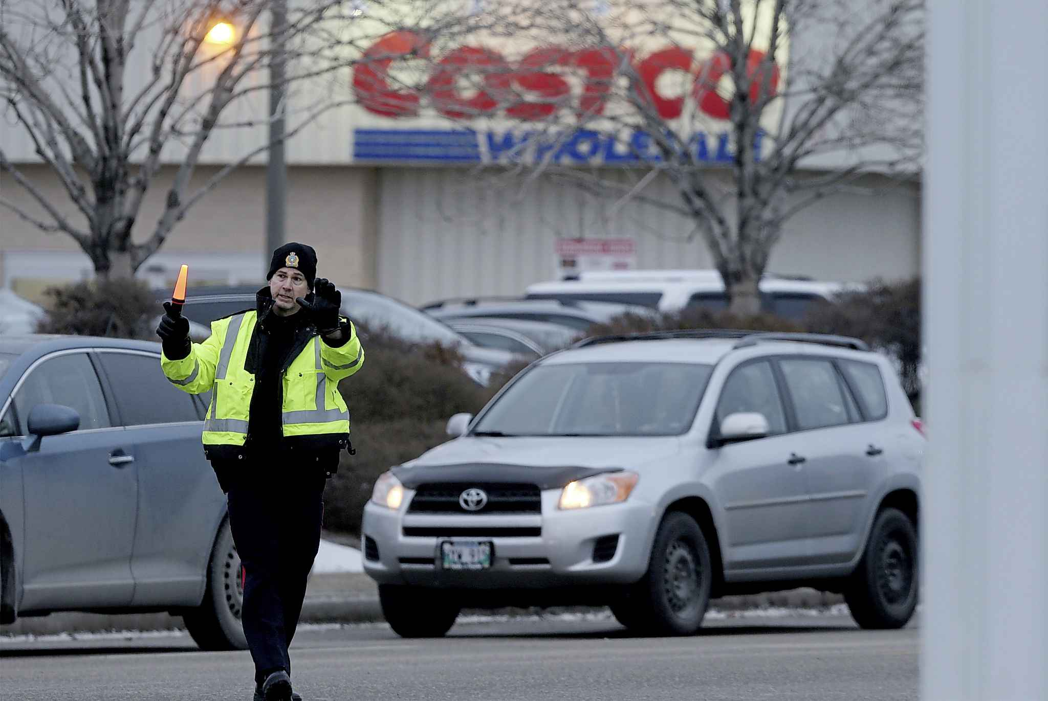 Members of the Winnipeg Police Service direct traffic in front of the St. James Costco store on Black Friday.