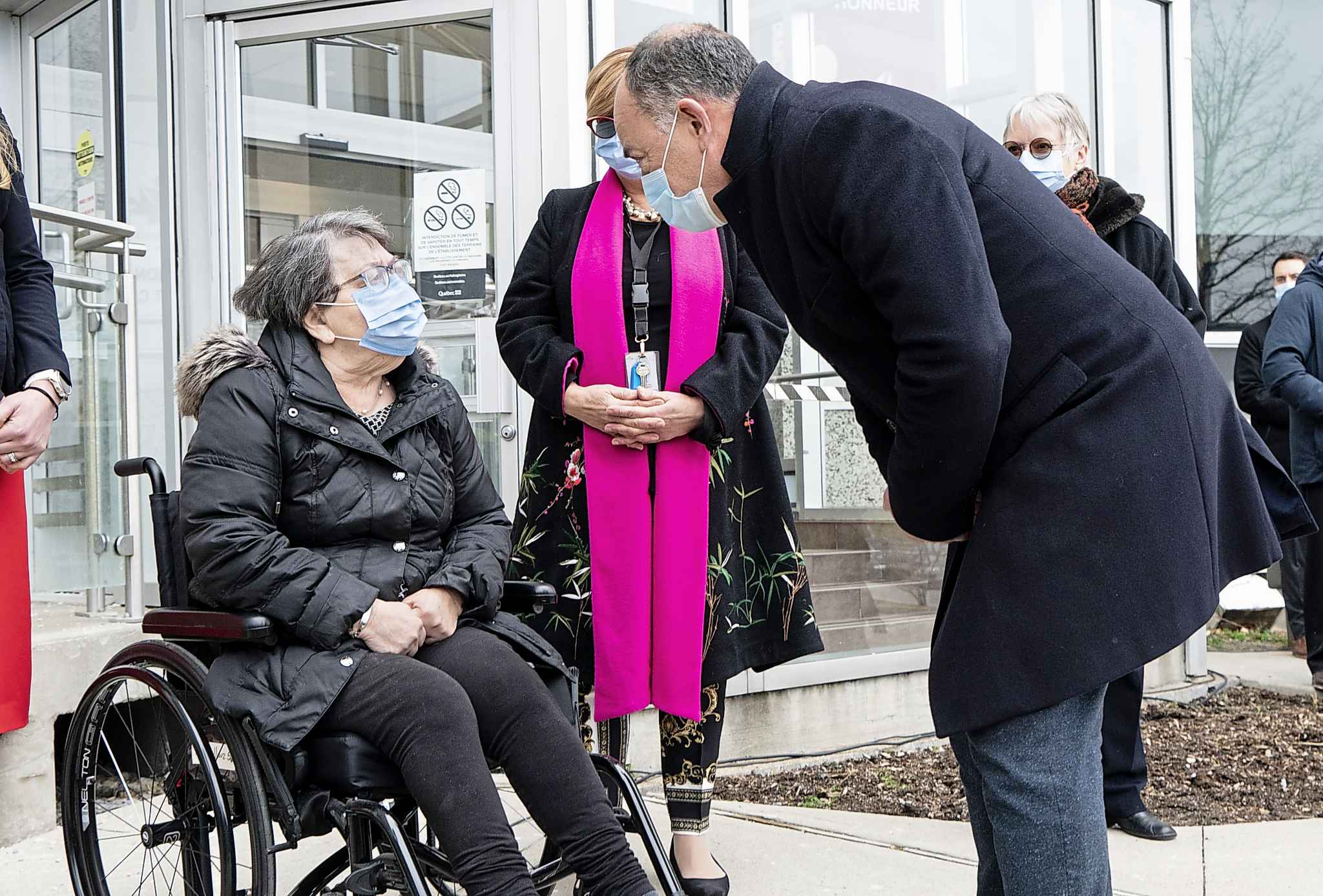 Quebec Health Minister Christian Dube greets Maimonides CHSLD resident Gloria Lallouz after she received a first dose of COVID-19 vaccine in Montreal, on Monday, December 14, 2020. THE CANADIAN PRESS/Paul Chiasson
