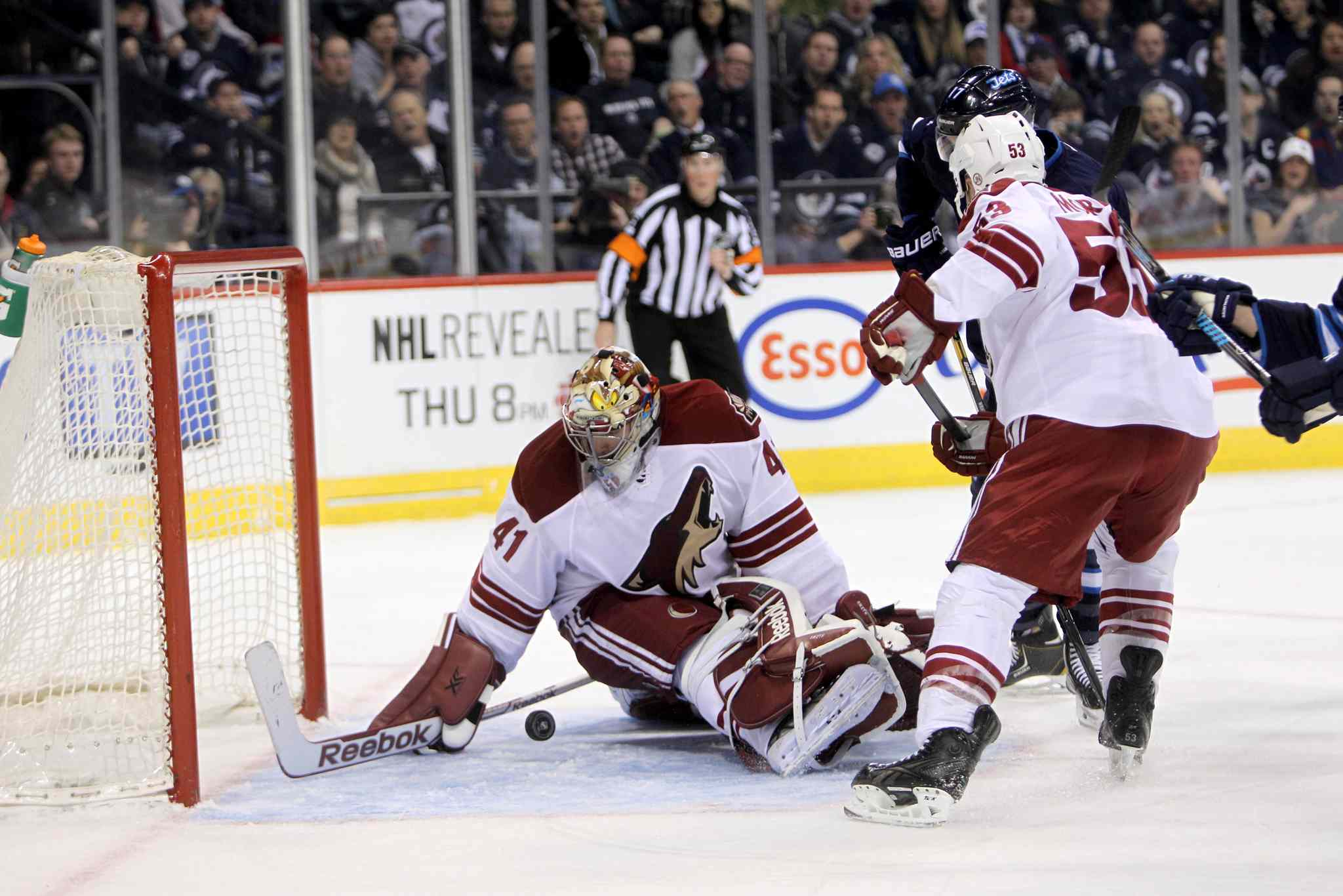 Phoenix Coyotes' goalie Mike Smith (41) manages to grab the puck before it goes into the net during the second period of  NHL action in Winnipeg Thursday night.