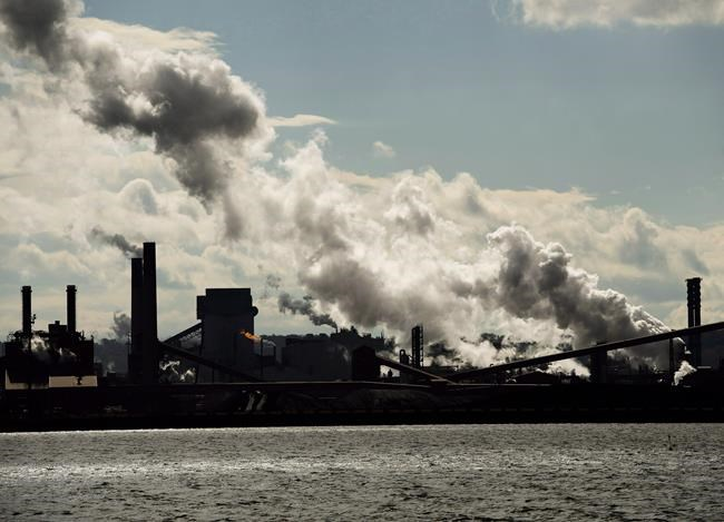 The steel mills in the Hamilton waterfront harbour are shown in Hamilton, Ont., on October 23, 2018. New research suggests air pollution at any concentration is harmful and that even levels below national and international guidelines are associated with an increased risk of death. Researchers with the University of British Columbia say there is at least a five per cent increase in the risk of death when comparing high- and low-pollution areas in Canada. THE CANADIAN PRESS/Nathan Denette