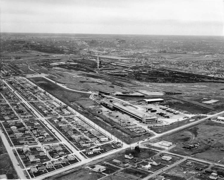 Winnipeg Free Press Archives May, 1964 Seen from the air, CP's mammoth new Merchandise Services terminal in Winnipeg dwarfs the automobiles and trucks on the large parking lot, and no wonder! The terminal, built at a cost of $1,450,000 can load or unload at one time 33 large highway, 33 local pick-up-and-delivery trucks, and 24 freight or express cars. Built-in mechanism in the terminal speeds parcels on their way at the rate of 180 feet per minute while safety features prevent loss, damage and misdelivery of parcels. In left foreground is a new housing development and in background CP Rail Weston Shops.