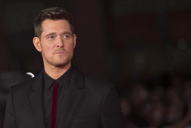 Canadian singer Michael Buble' arrives for the screening of the movie ' Tour Stop 148 ' at the Rome Film festival in Rome, Friday, Oct. 14, 2016. The Juno Awards make a splash tonight in Vancouver with an eclectic lineup of rising stars and established favourites paying tribute to Canada's music scene. THE CANADIAN PRESS/AP, ANSA