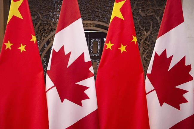 Flags of Canada and China are seen prior to a meeting of Canadian Prime Minister Justin Trudeau and Chinese President Xi Jinping at the Diaoyutai State Guesthouse in Beijing on Dec. 5, 2017. China has formally arrested two Canadian citizens it's been holding since December in an apparent effort to pressure Canada into releasing a Chinese telecom executive. THE CANADIAN PRESS/AP, Fred Dufour, Pool Photo