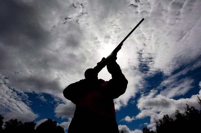 "A rifle owner checks the sight of his rifle at a hunting camp property in rural Ontario west of Ottawa, Sept. 15, 2010. The Canadian Sports Shooting Association has launched a national petition that asks Ottawa to establish a single ""civilian agency"" in place of provincial and territorial firearms officers that oversee licensing and other gun regulations. THE CANADIAN PRESS/Sean Kilpatrick"